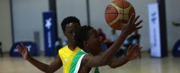 A player dribbles basketball at the Sasol NWU Junior tournament