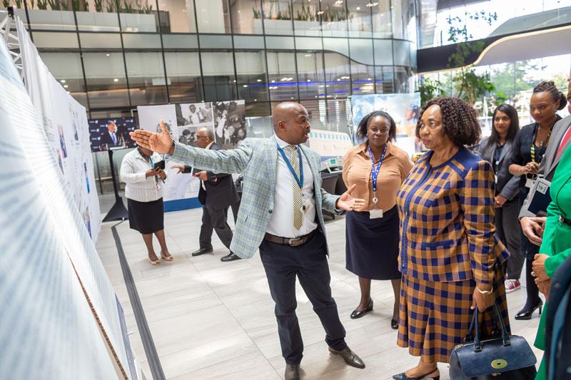 Minister of Education walks around the Sasol Foundation exhibition