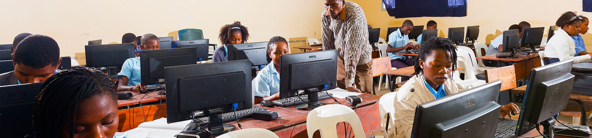 children seating in a computer class