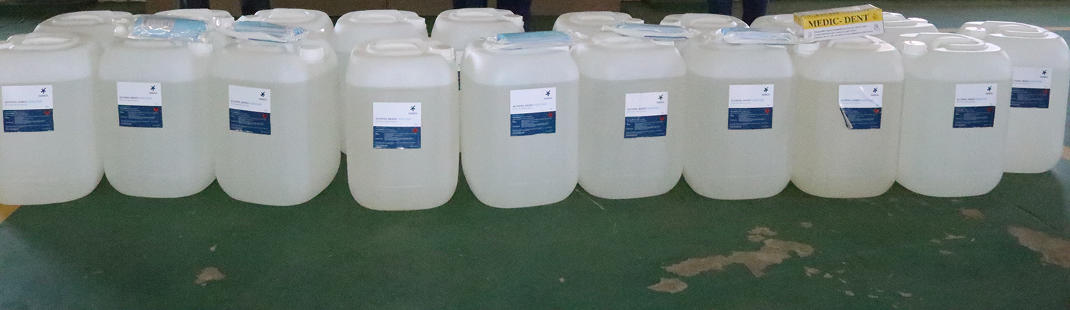 bulk sanitiser being donated to hospital