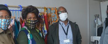 People posing wearing masks designed by Mampoi exclusive designs.