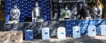 City of Joburg officials standing during the handover of COVID-19 supplies by Sasol