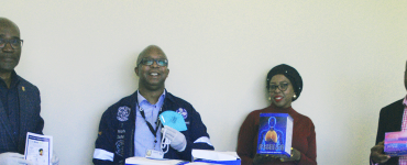 Dignitaries posing with PPE items being donated to Fezile Dabi District Department of Health to fight COVID-19